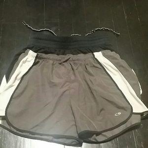 Two pairs of Champion women's running shorts.